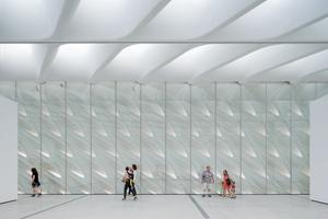 Third-floor galleries with skylights and interior veil