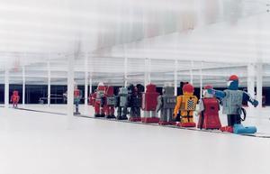Robots on 300' conveyor belt