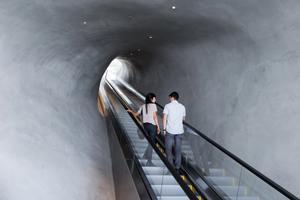 Escalator through the vault to galleries