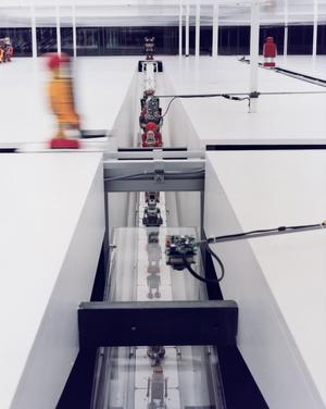 Robots on 300' conveyer belt