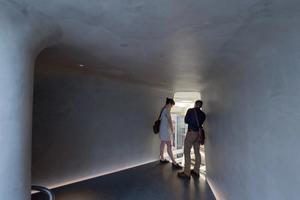 Visitors peering into vault below