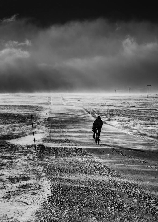 Jens riding his bike in a winter landscape