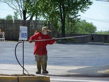 spraying-sealcoat-by-wand