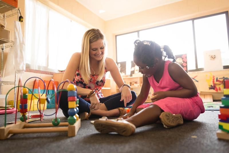 ABACS student working on techniques with a child at Rollins' Child Development Center.