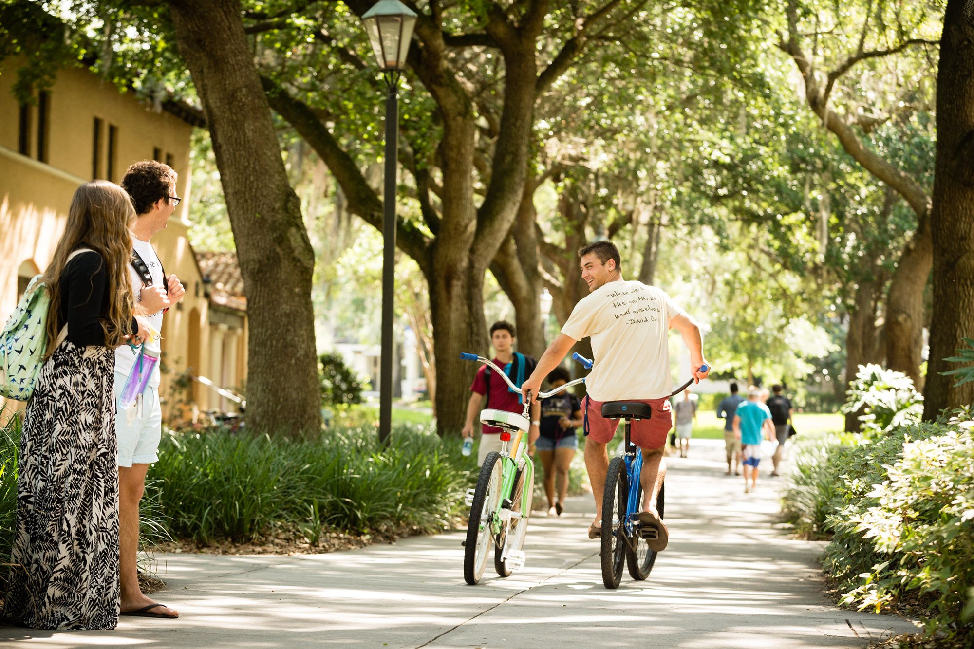 A student participating in Rollins' bike-share program.
