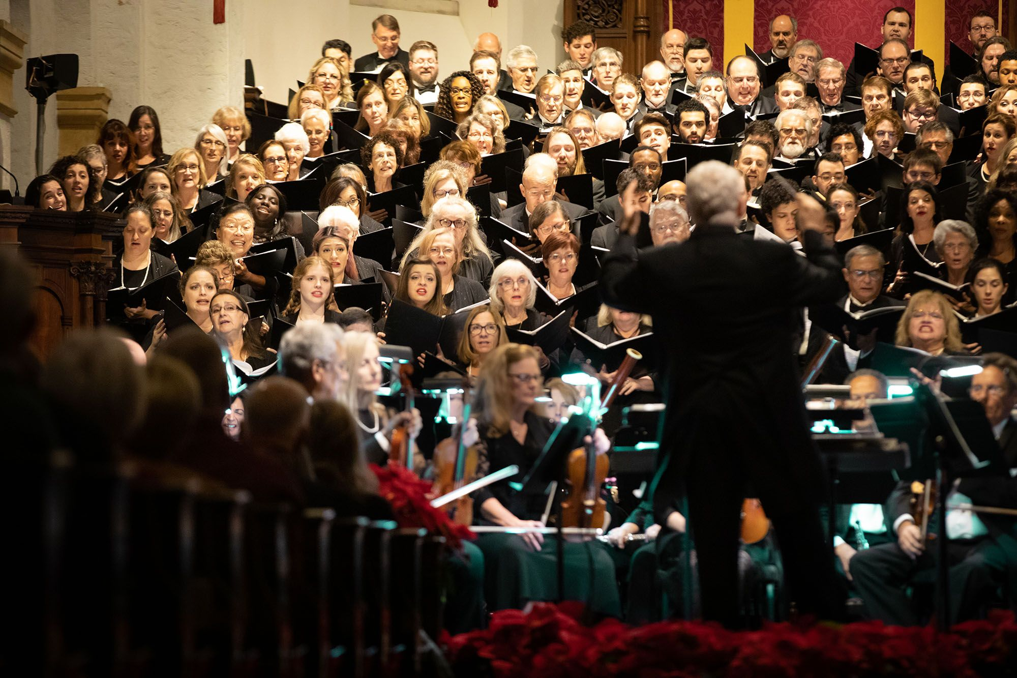 Music professor John Sinclair conducting the Bach Festival Choir holiday concert, which aired on PBS.
