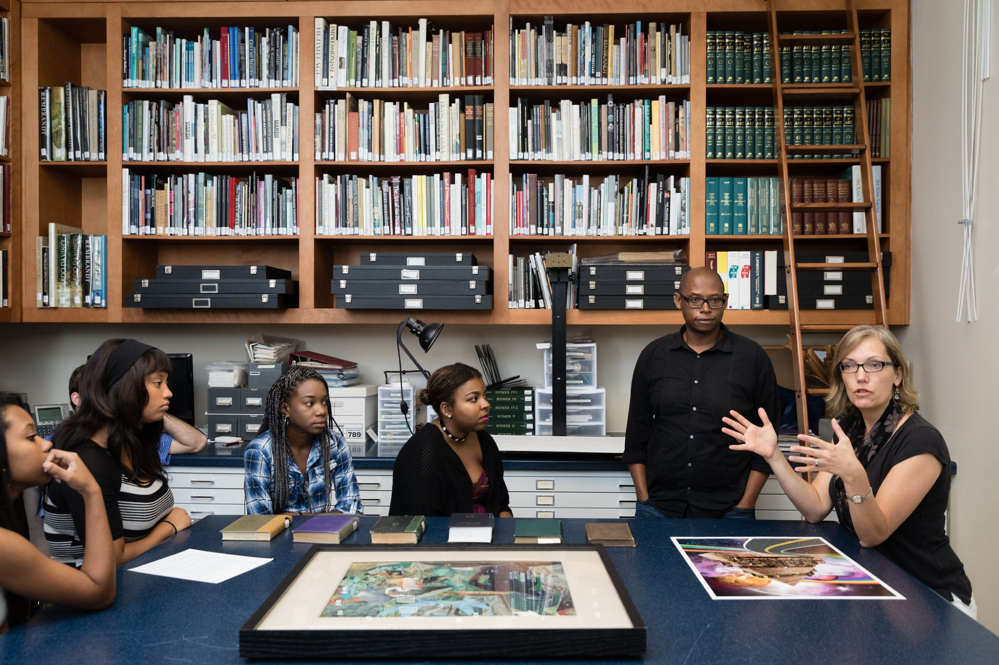 Professor Chambliss and students discussing art in the CFAM.