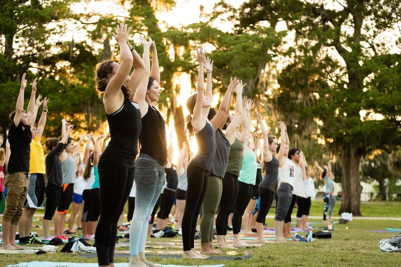 Students participating in an outdoor yoga class on campus.
