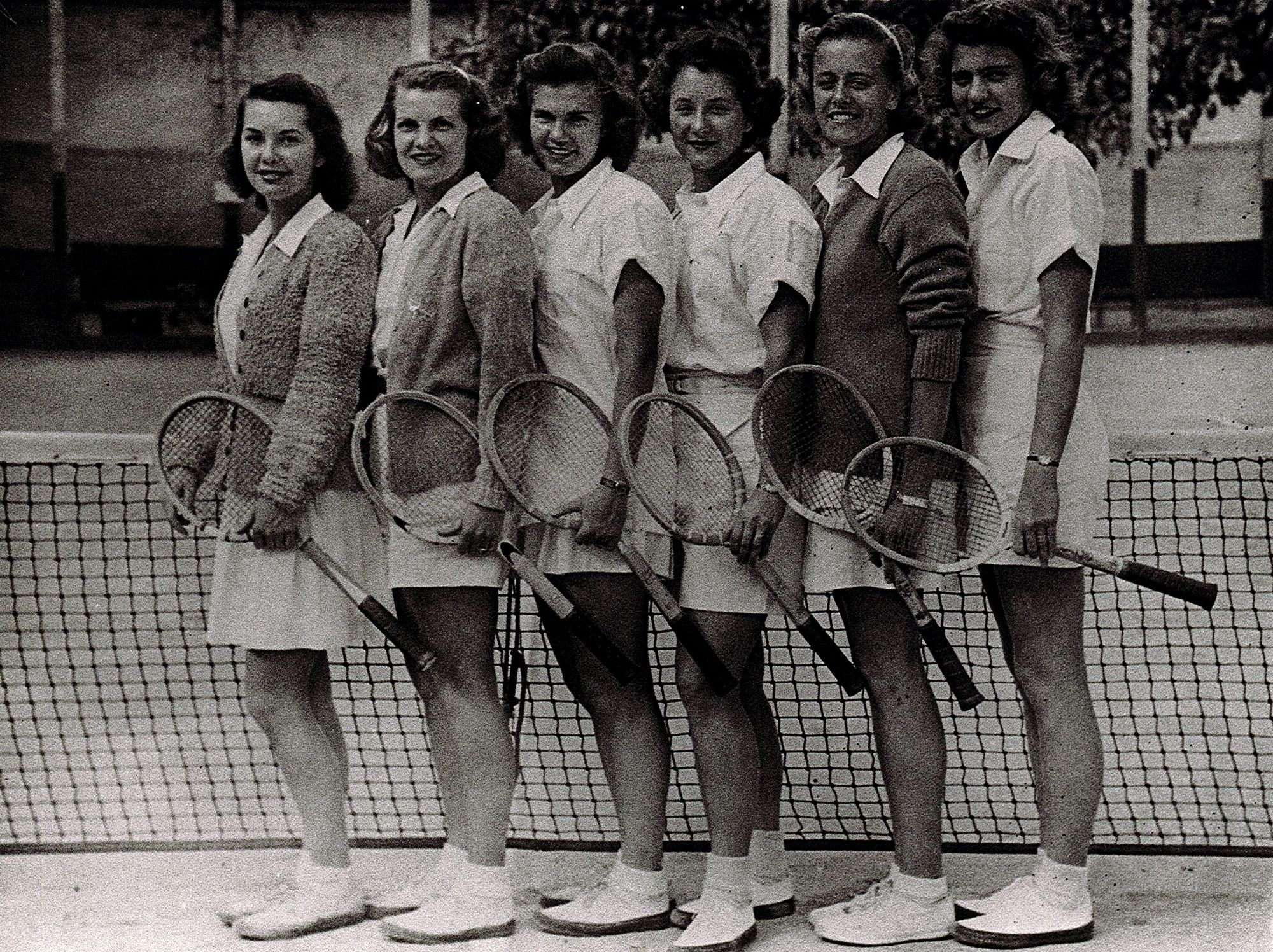 Shirley Fry Irvin '49 pictured on the tennis court at Rollins College with five of her teammates.