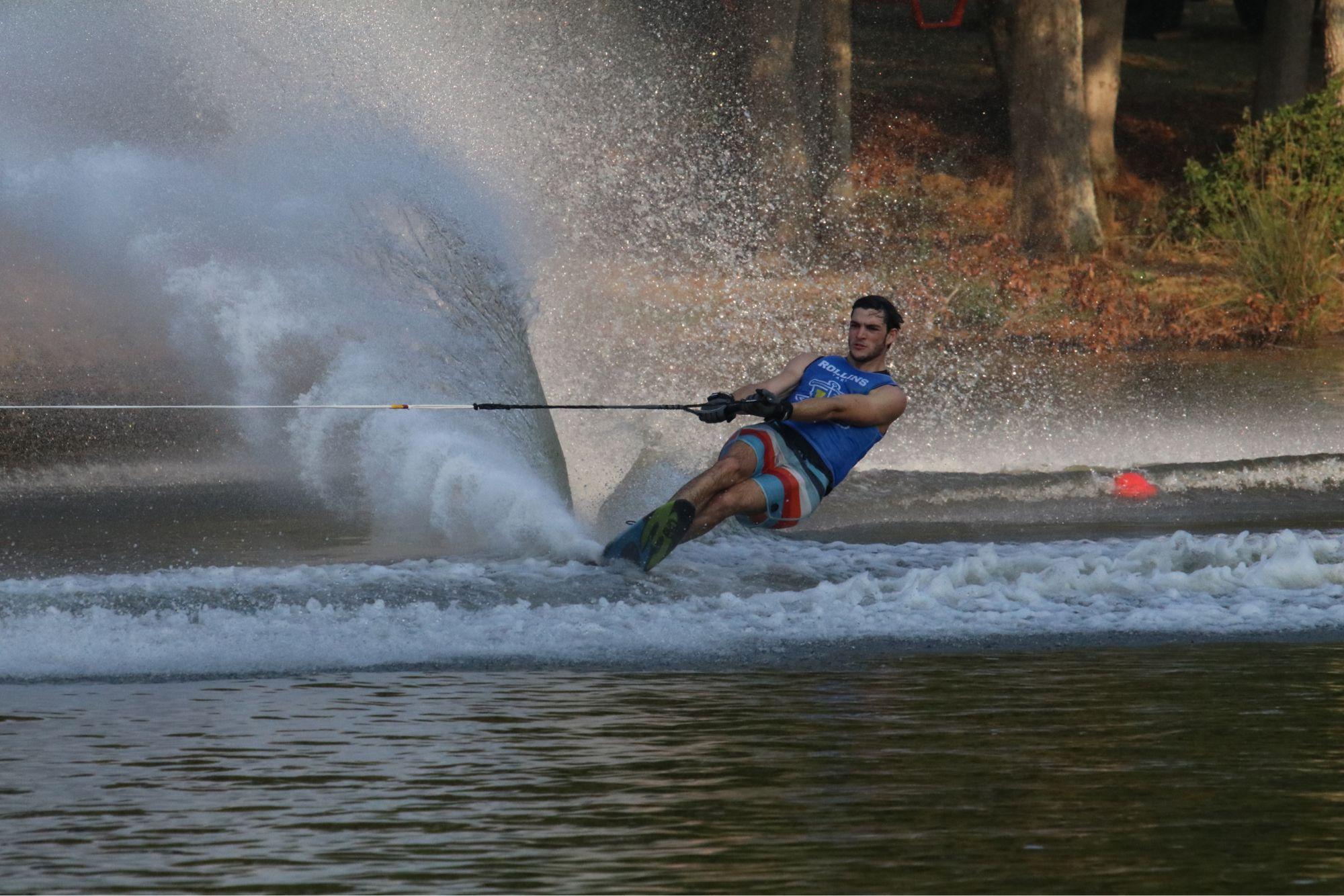 A skier wakeboarding on Lake Virginia.
