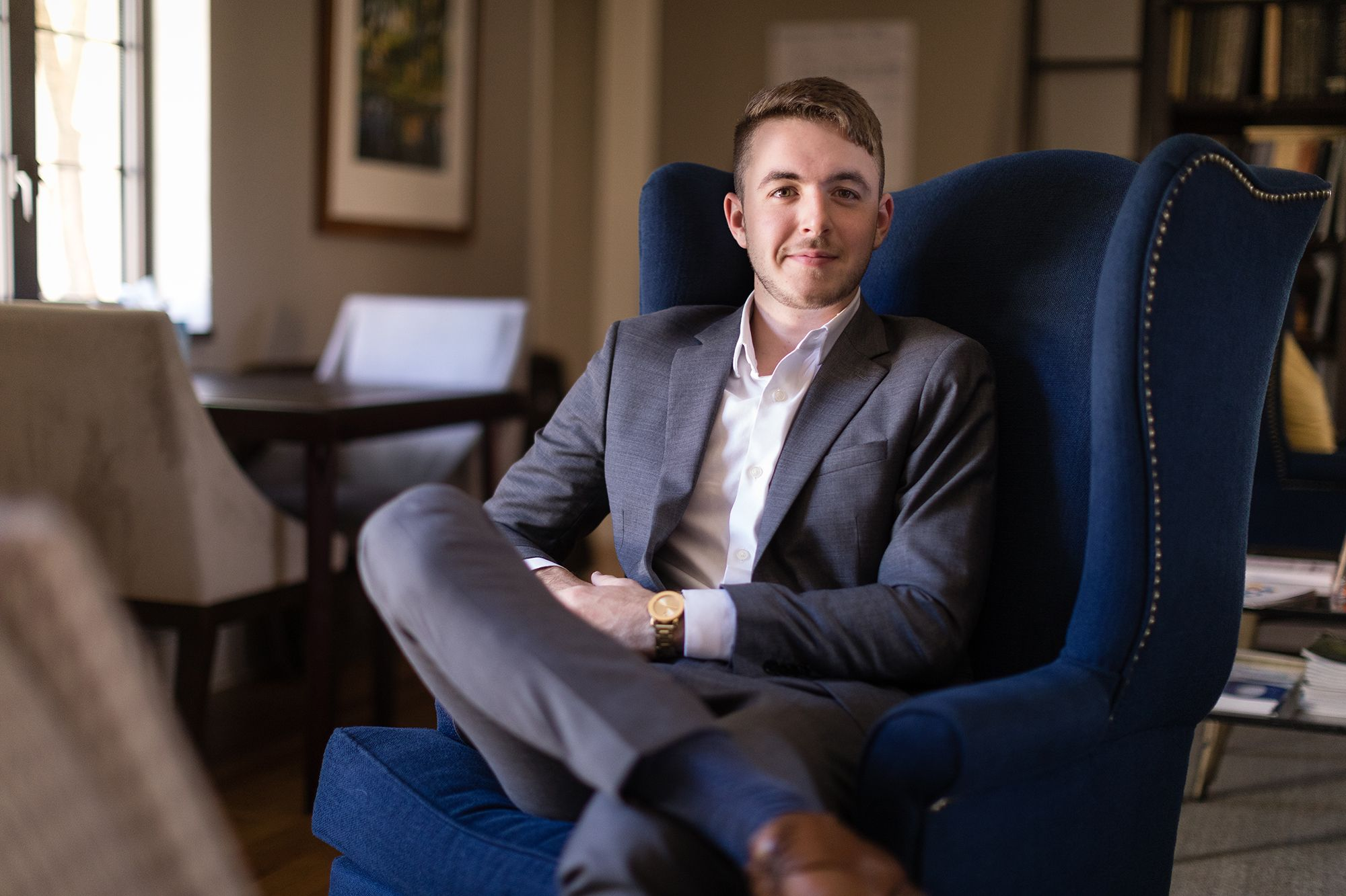 Ryan Colango sitting in blue chair.