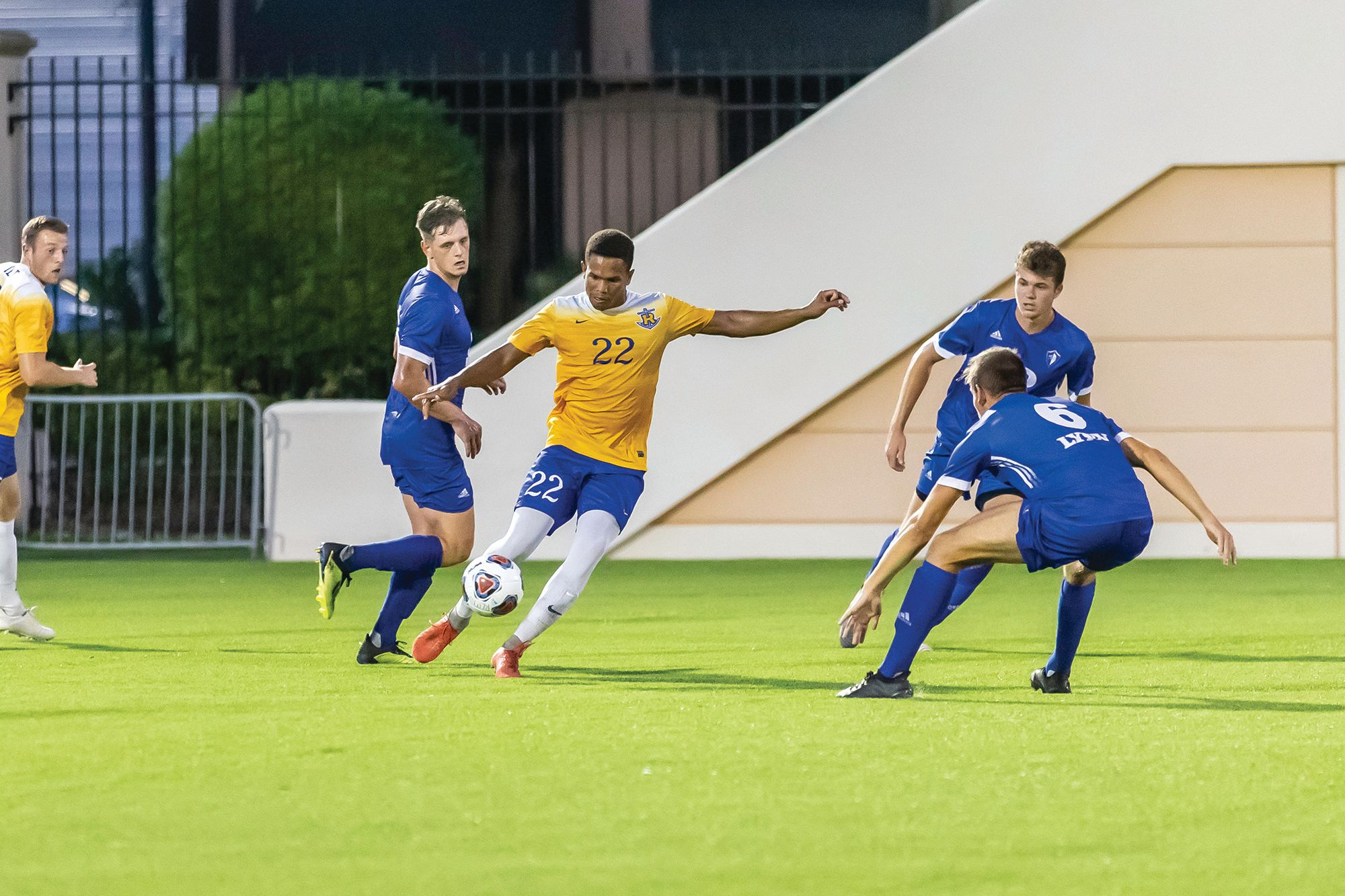 Damian Clarke '19 playing a soccer game as a midfielder.