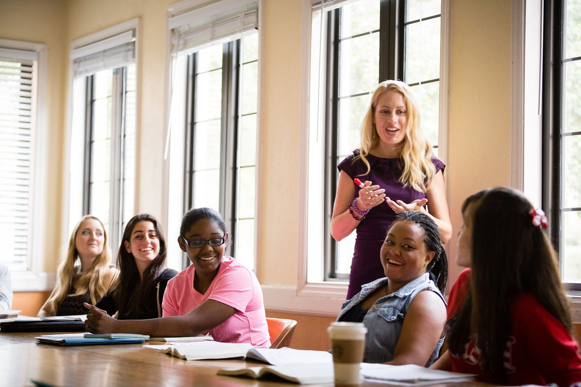 English college professor mentoring her students.