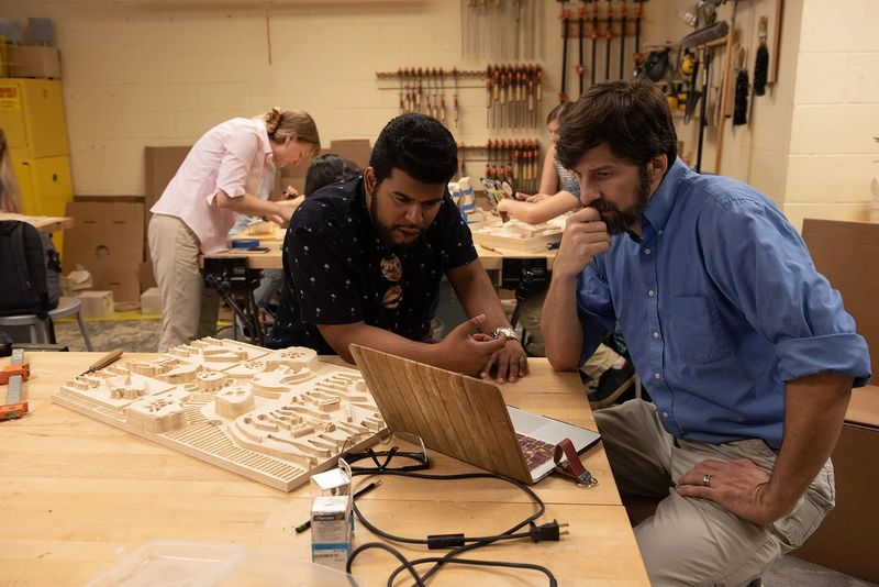 Students work on a project which combines science and art.