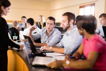 A group of MBA students collaborate on a project.