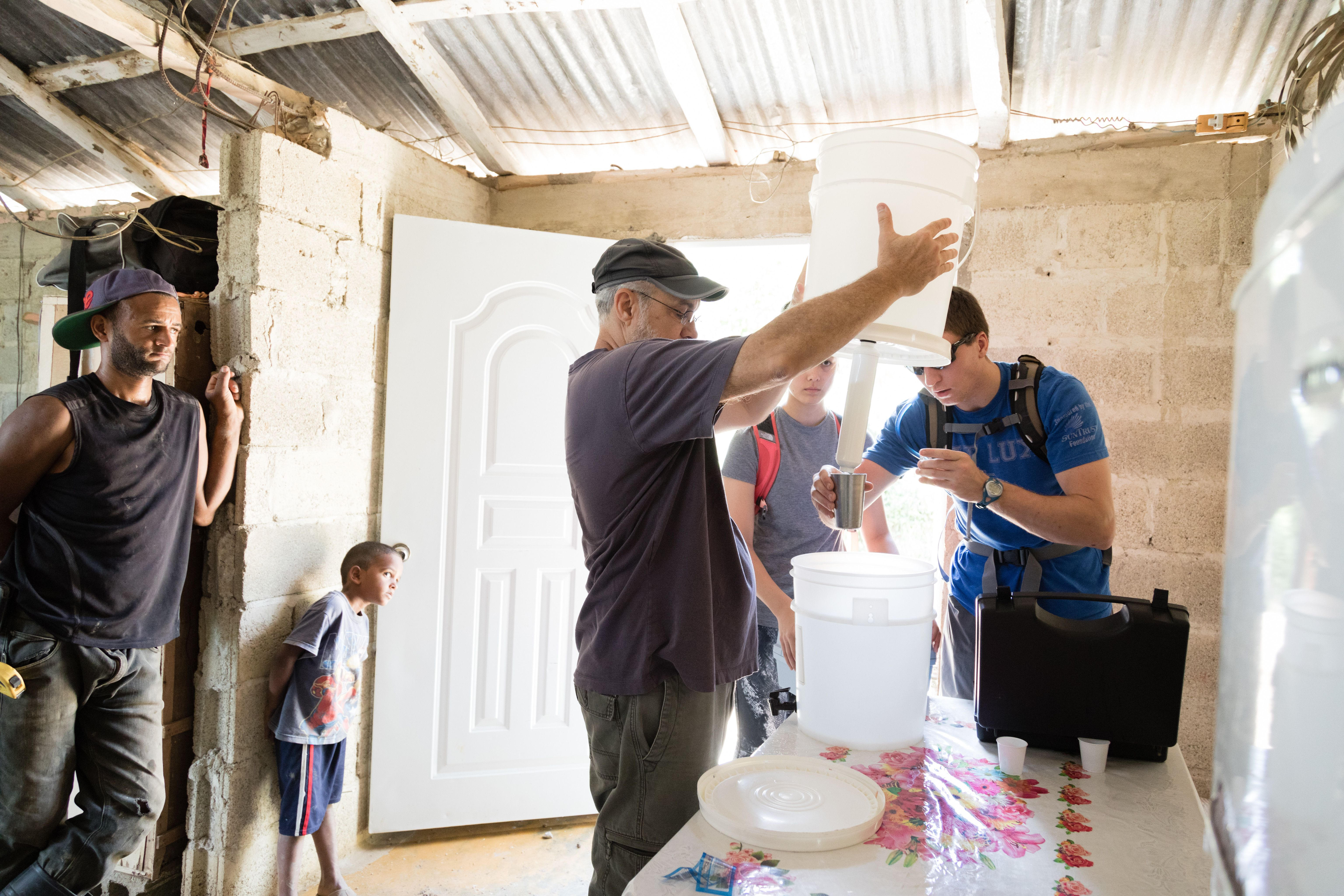 Chemistry professor Pedro Bernal and his students test a water filtration system in the Dominican Republic.