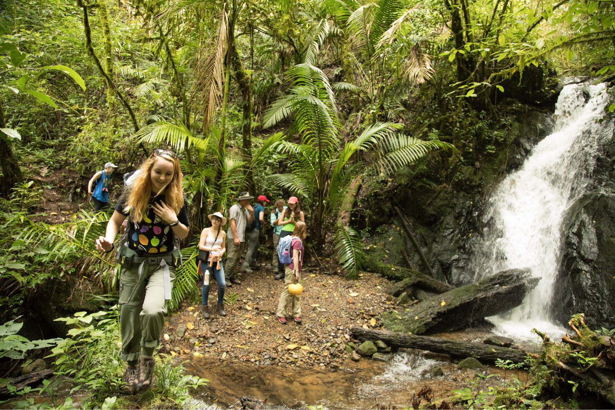 Students in Costa Rica admiring a waterfall.