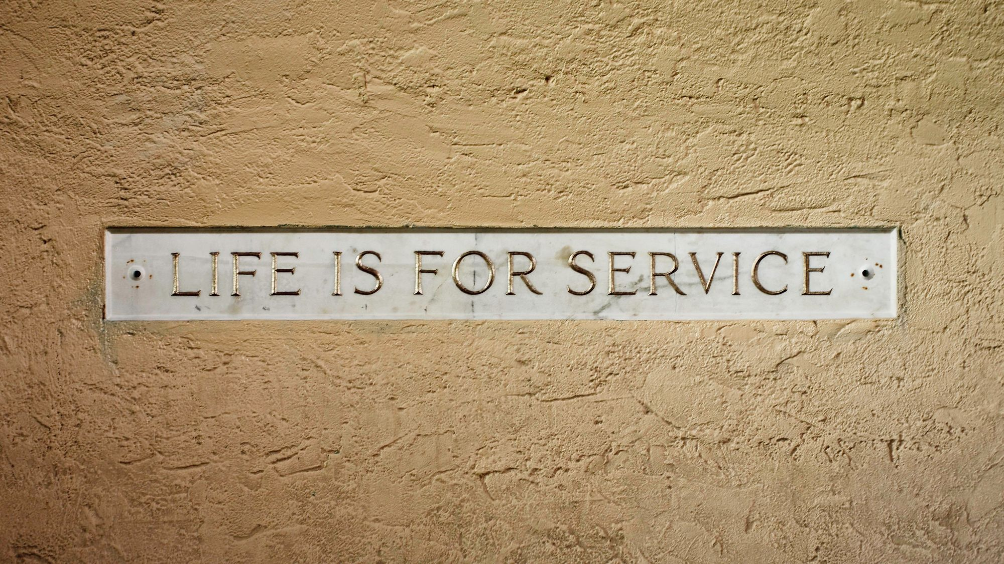 Life is for Service engraving near Strong Hall at Rollins College.