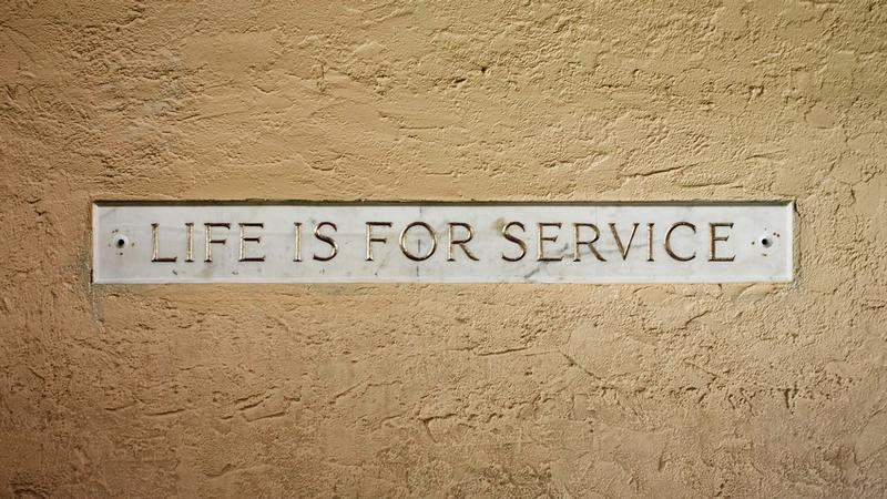 A picture of the Life is for Service plaque at Rollins College.