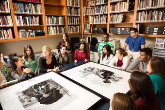 Art History students in the library of the Cornell Museum of Fine Arts.