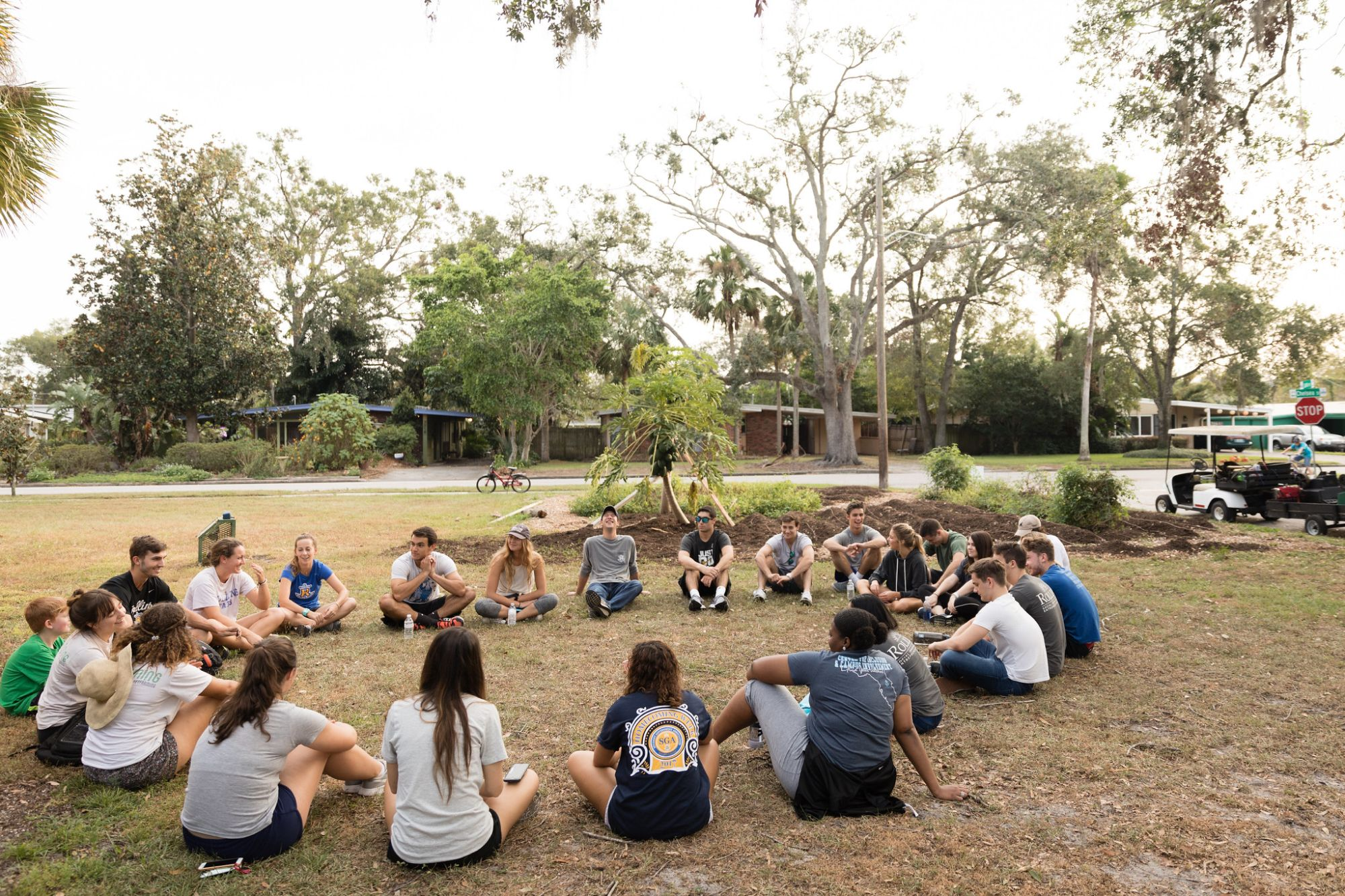 Students sit in a large circle.