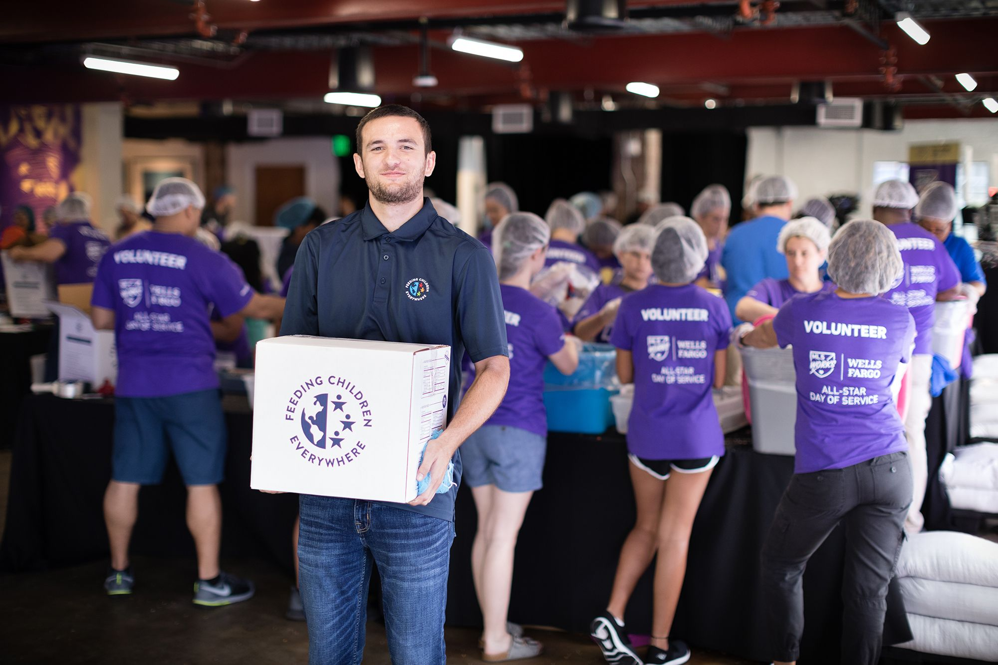 A liberal arts college alumn serves others by helping to feed chilrden everywhere.