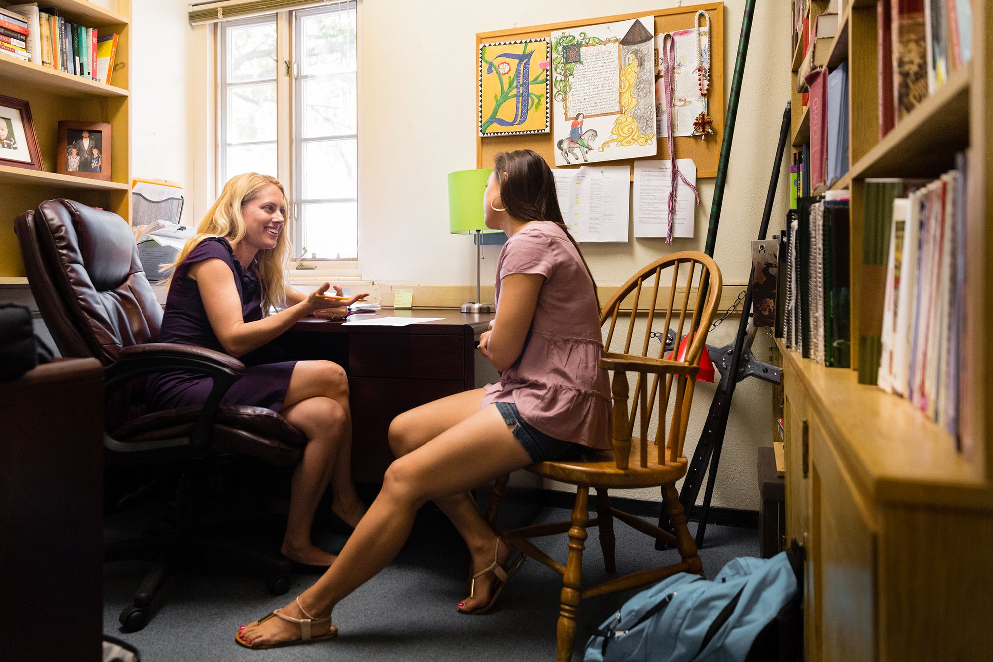 A professor advises a student one on one.