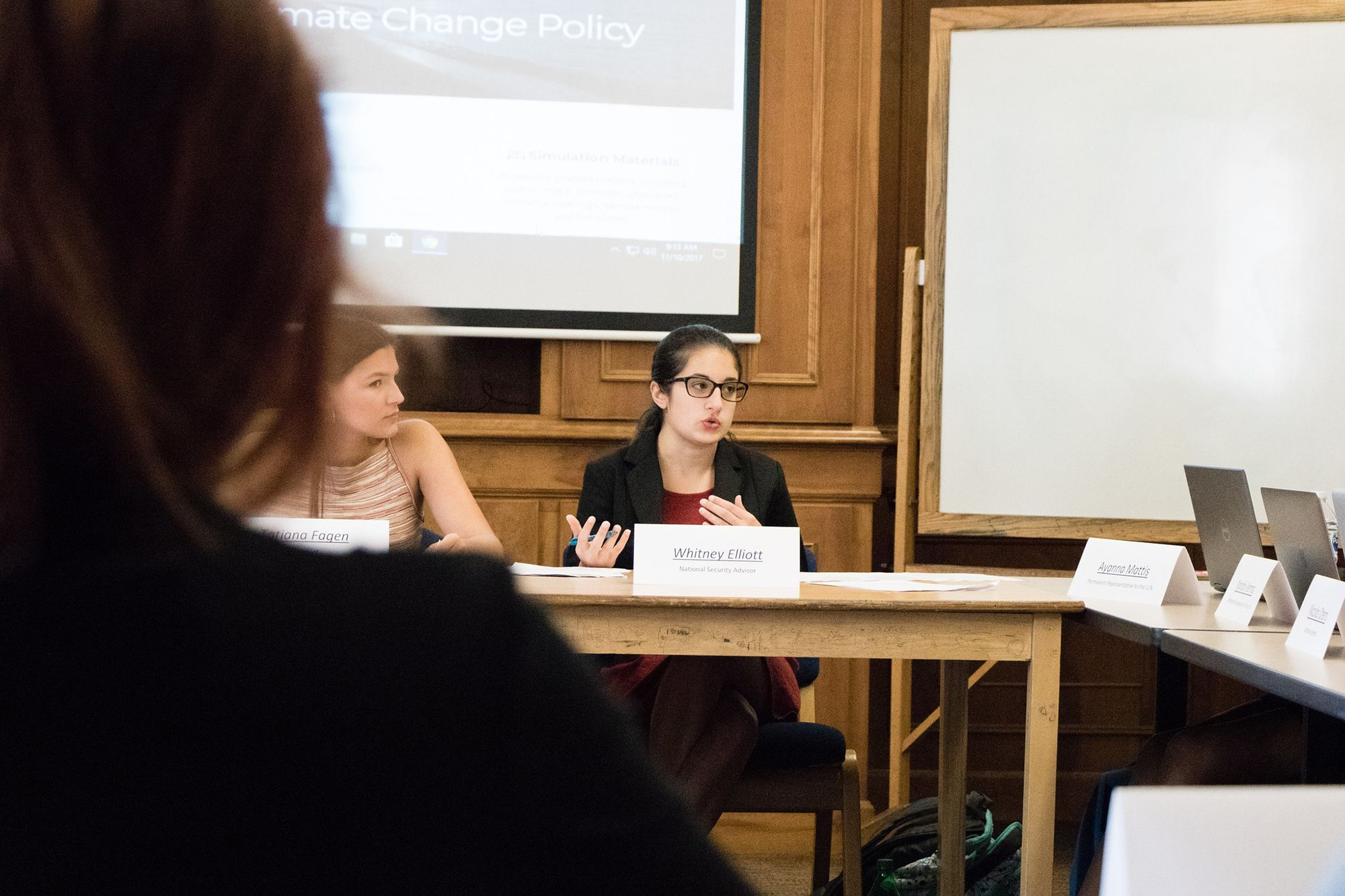 Rollins student speaking about climate change policy as part of a Model UN.