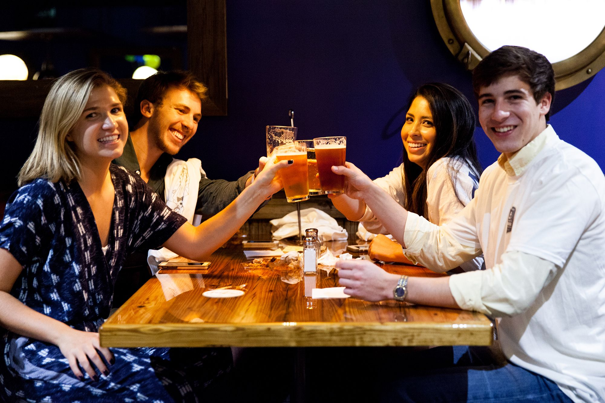 Students enjoy relaxing together at Dave's Boathouse, the pub-style eatery on campus.