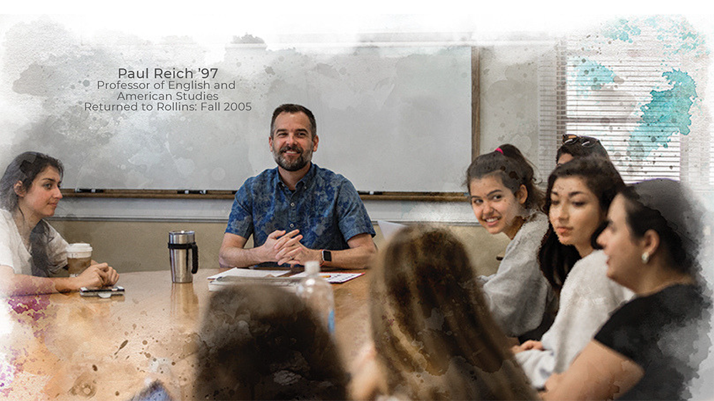 English professor Paul Reich in the classroom with students around an oval table.