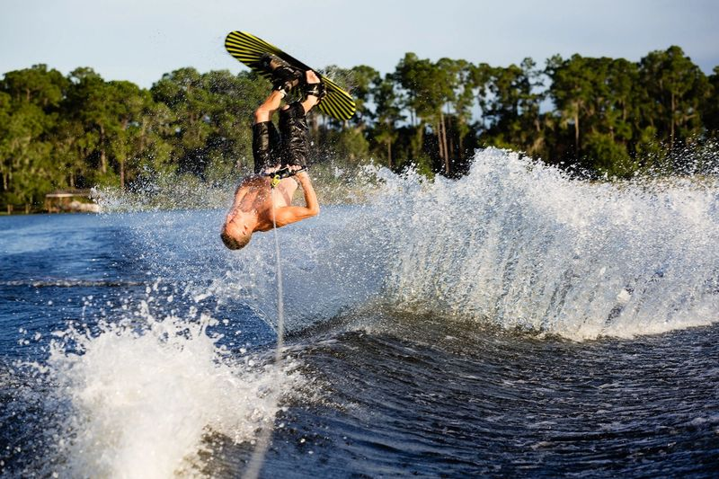 Student wakeboarding on Lake Virginia.
