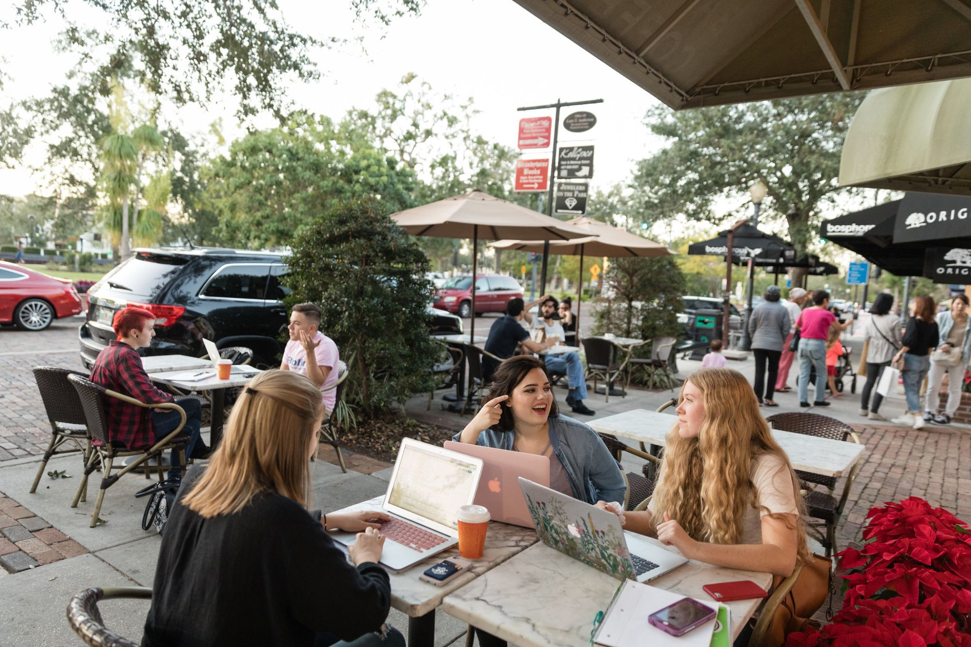 Students collaborate on blog content for local favorite Barnie's CoffeeKitchen outside on Park Avenue.