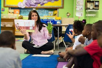 Student teacher conducting reading instruction in a local elementary classroom.