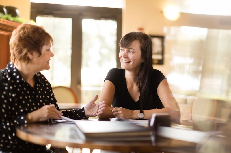 A student meets with a financial aid counselor.