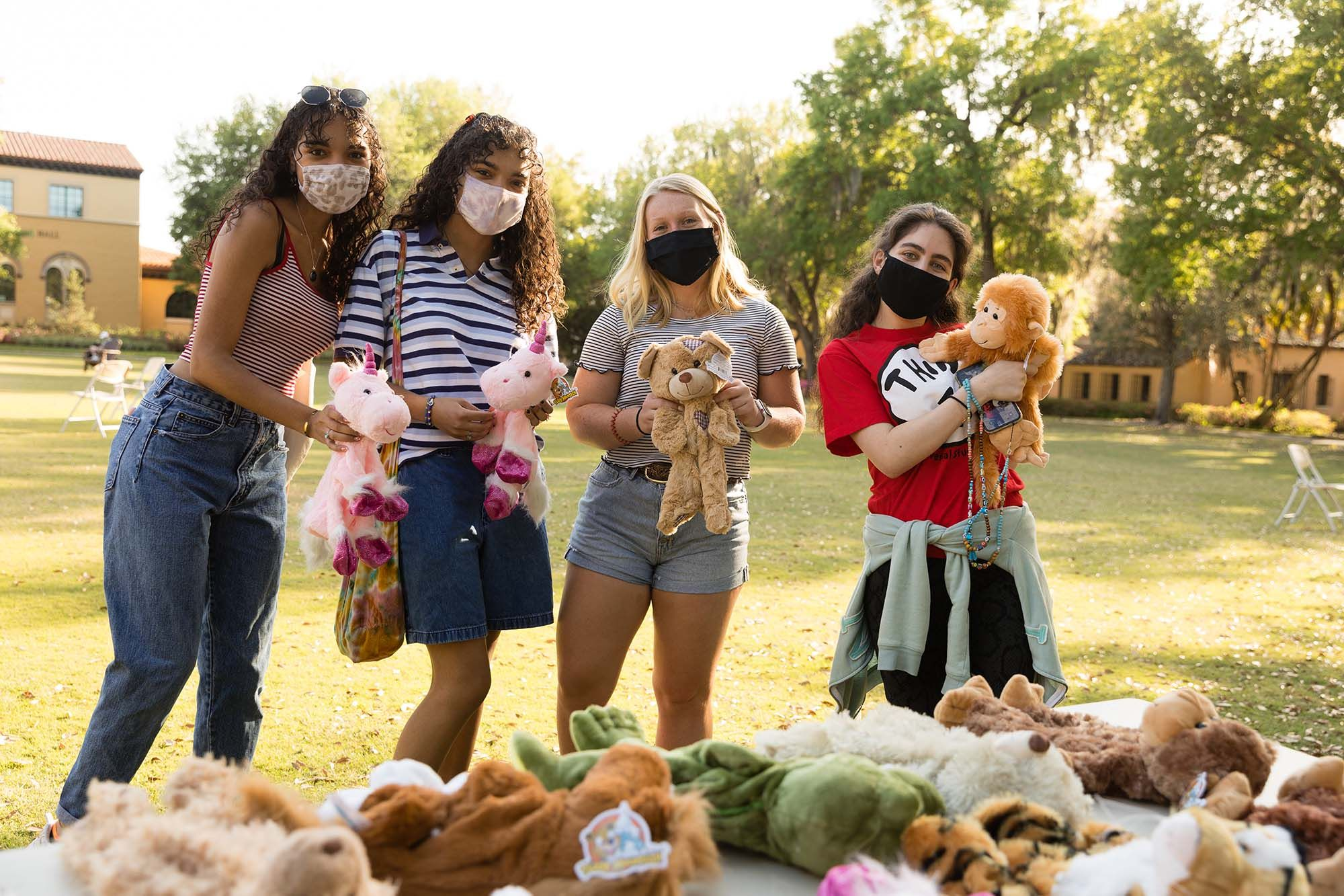 Students pose with stuffed animals