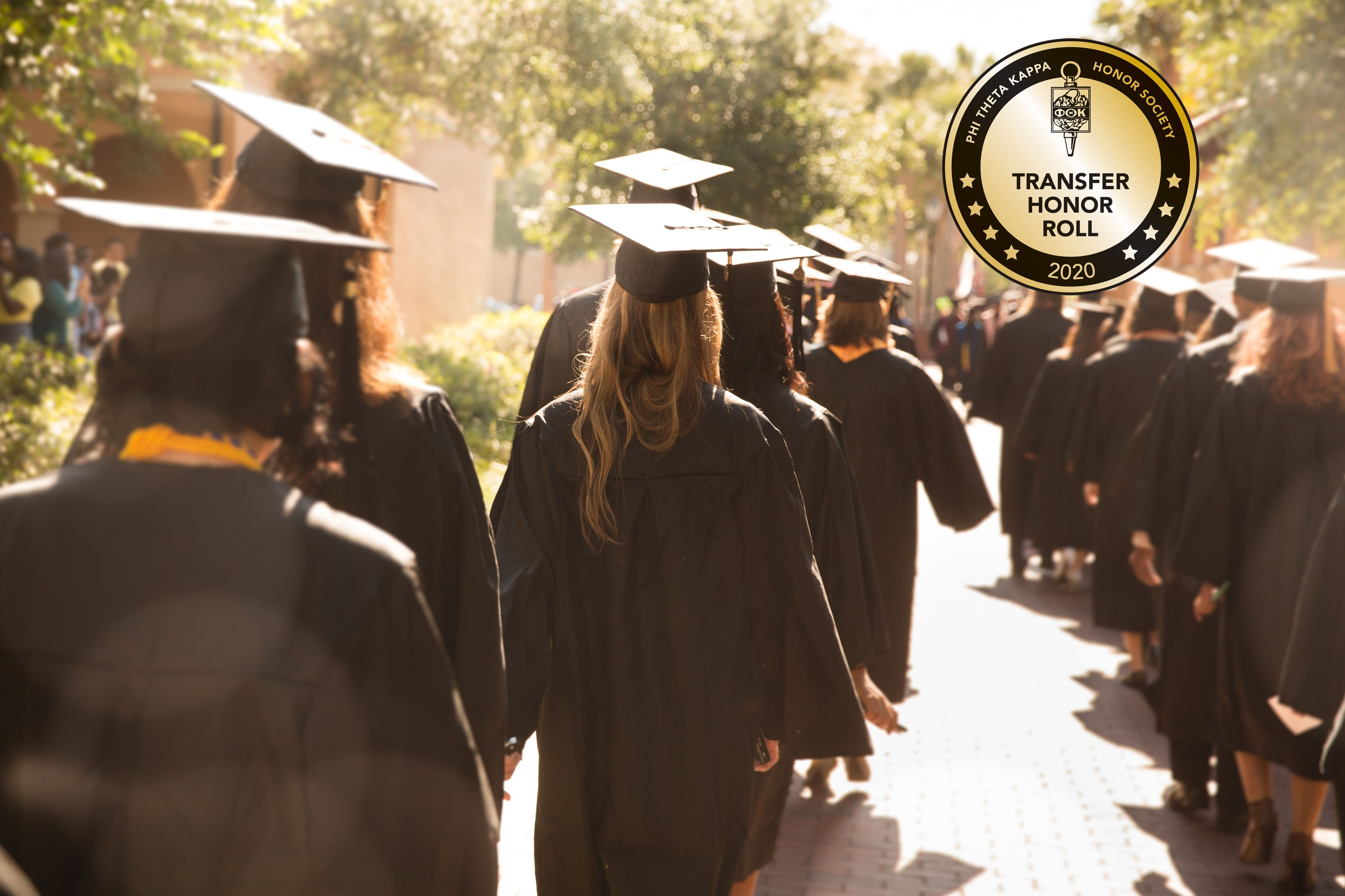 Students in gaps and gowns walk to commencement at Rollins College, one of the best colleges for transfer students.