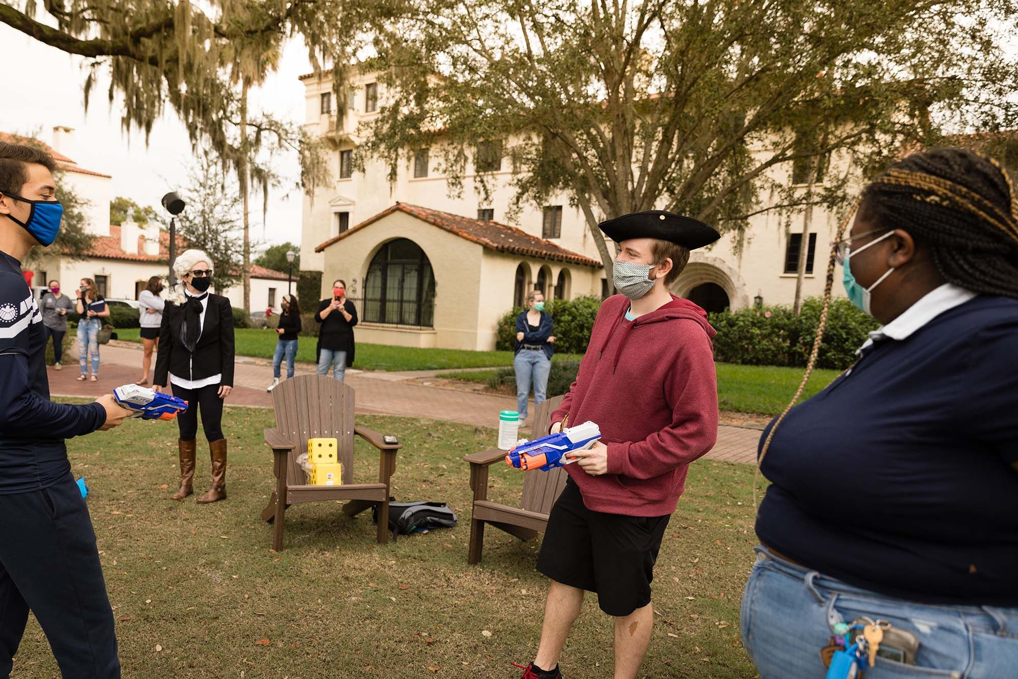 Students in costumes hold nerf guns
