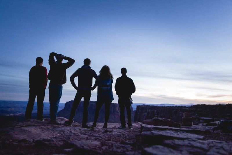 Students stand on the edge of a canyon.