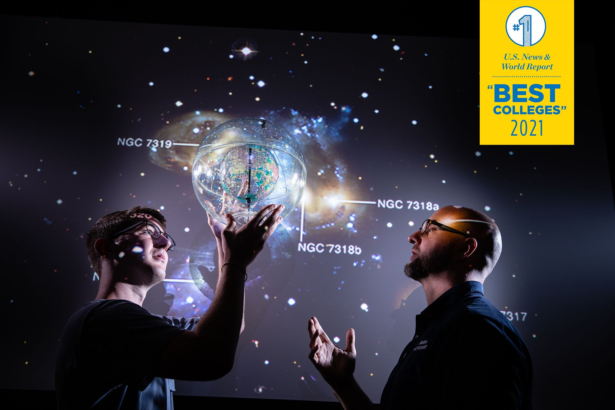 Physics professor and student exploring the universal via digital projection.