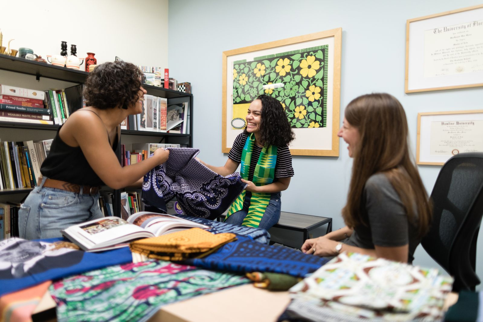 Students collaborate on textile research in the Cornell Fine Arts Museum.