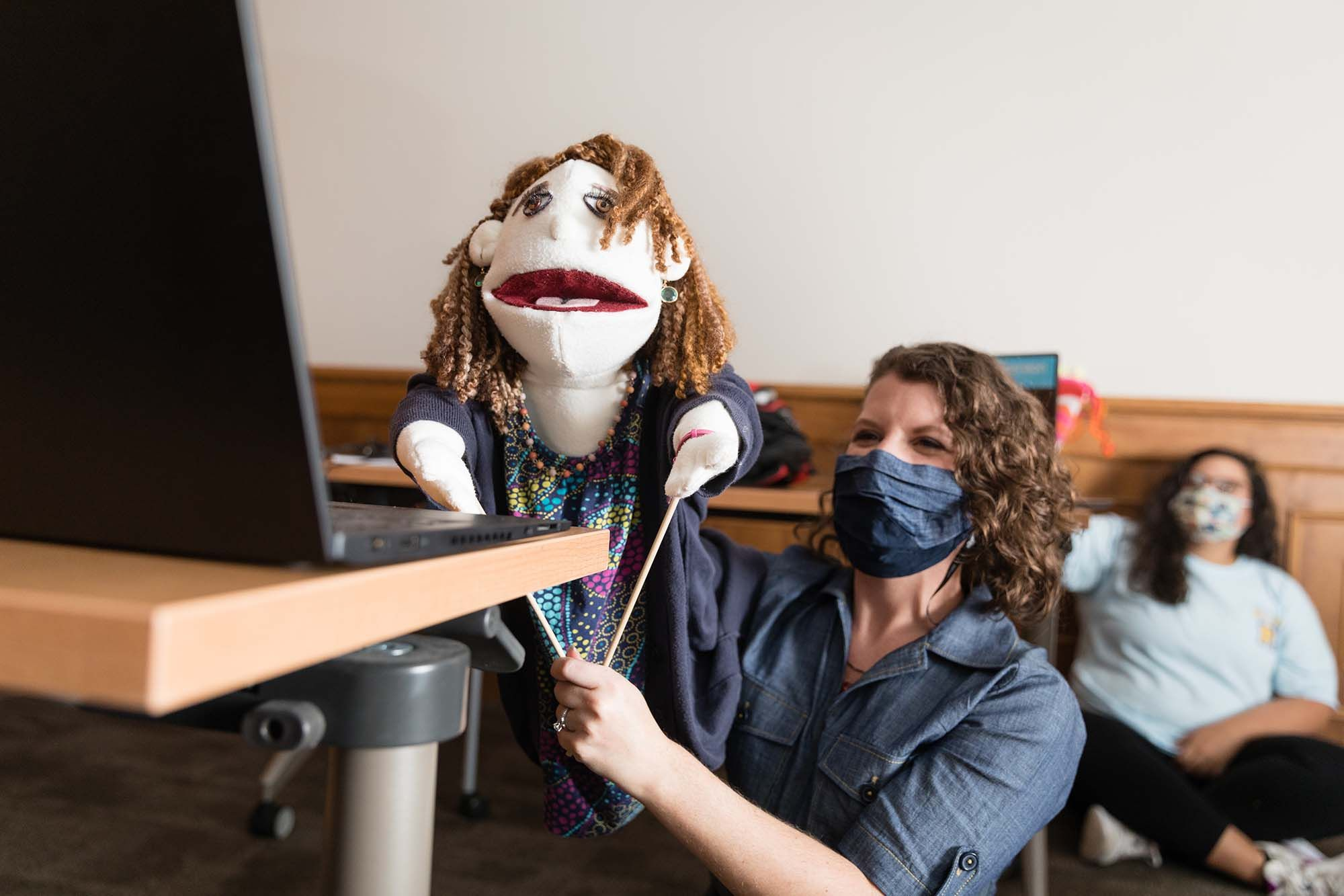 Instructor Sarah Parsloe poses with a puppet