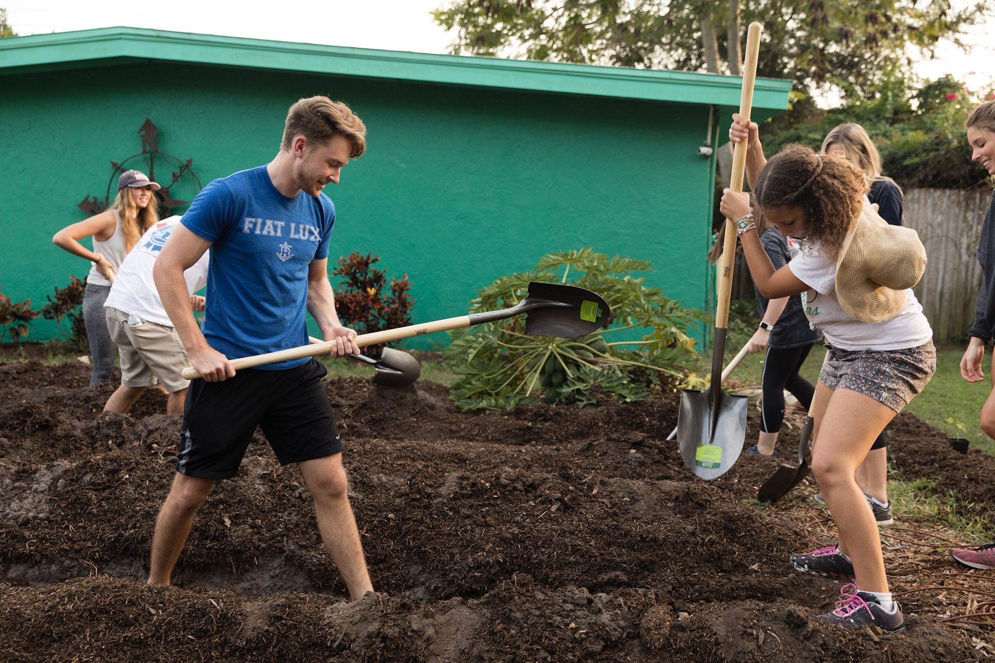 A group of students prepares a residential urban farm.