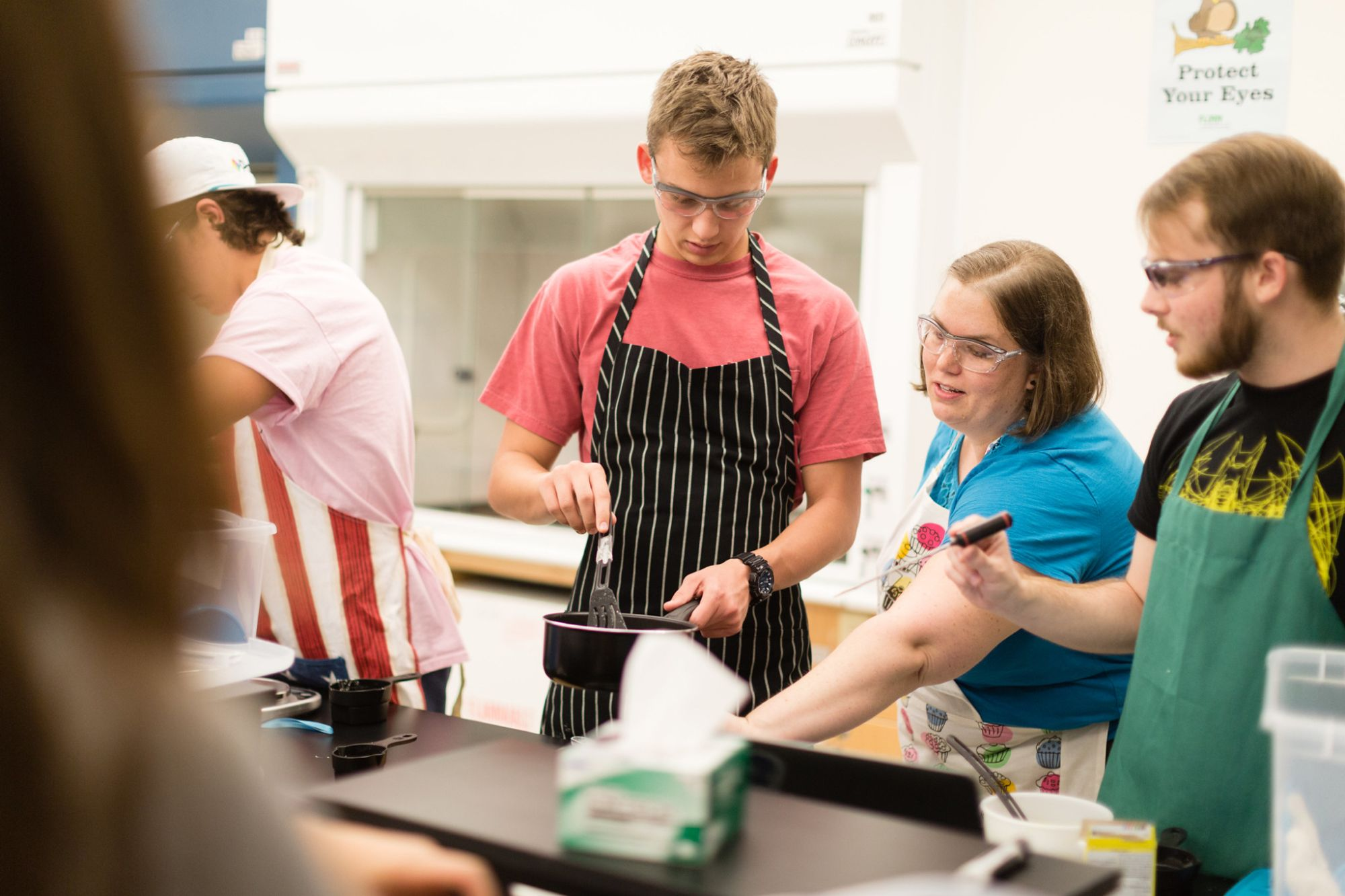Students prepare gelatin during a chemistry experiment.