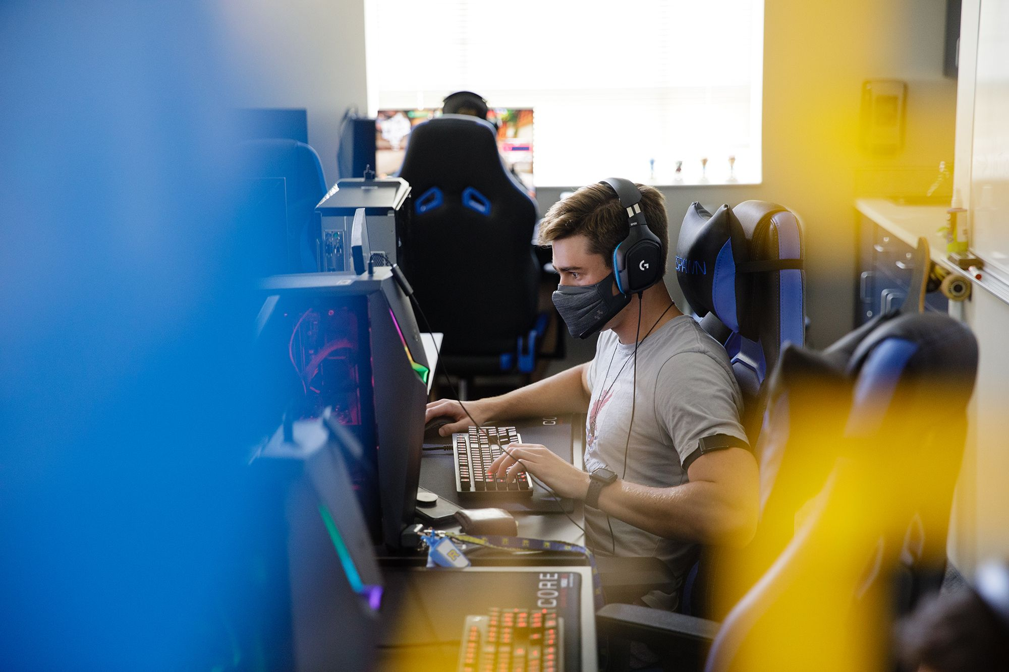 Student playing a video game in Rollins' esports room.