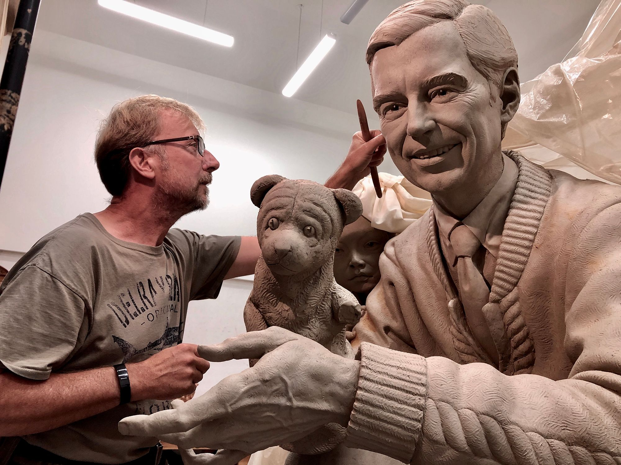 Artist Paul Day working on the sculpture of Mister Rogers for Rollins College.
