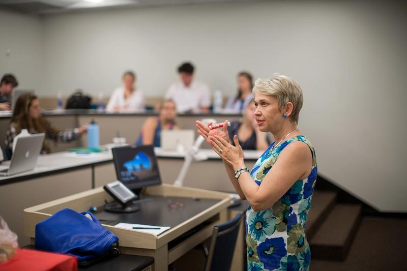 An economics professor leads a class discussion.