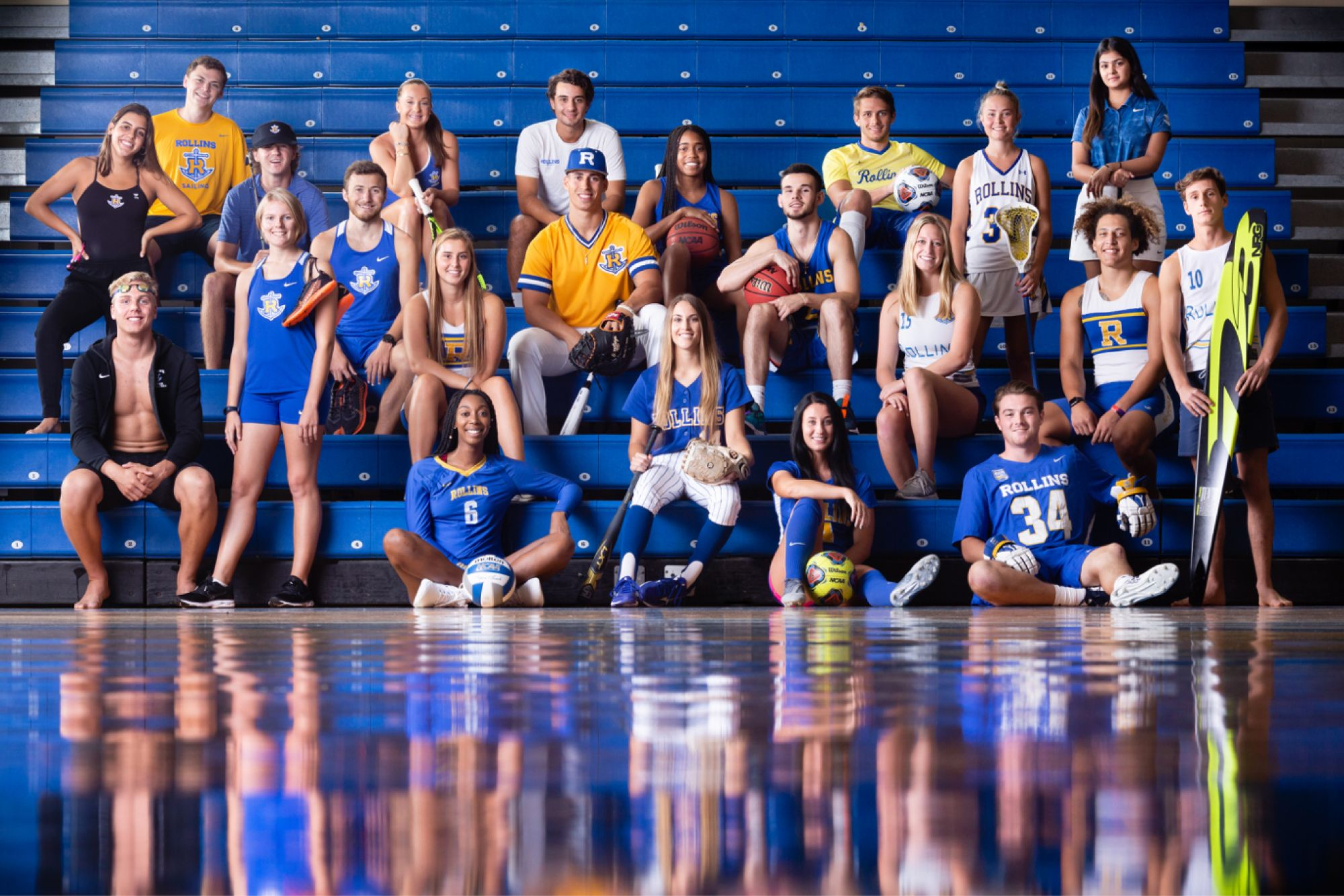 Group photo of all the different athletes in their uniforms.