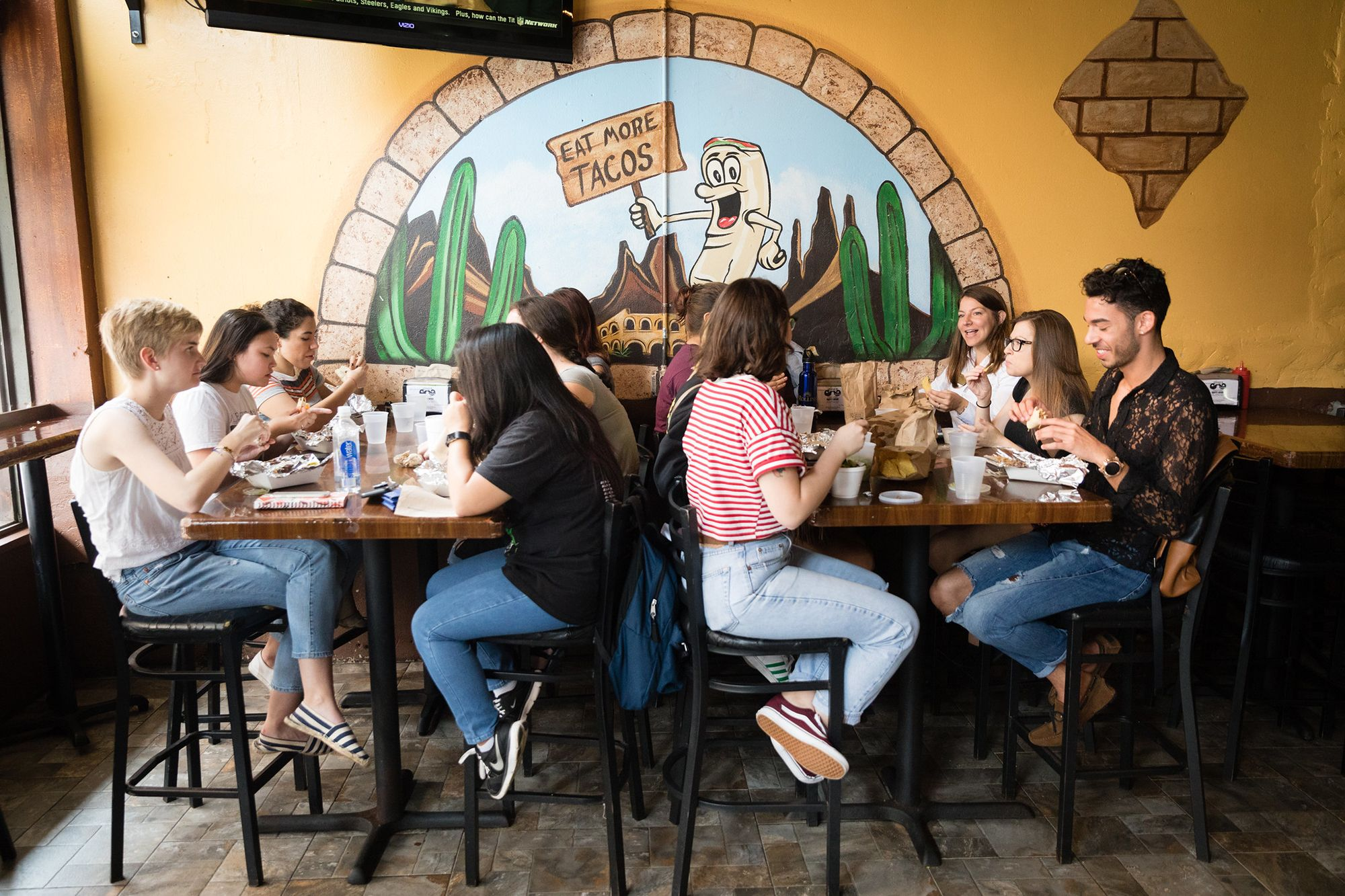 Students eat at Gringos Locos in downtown Orlando.