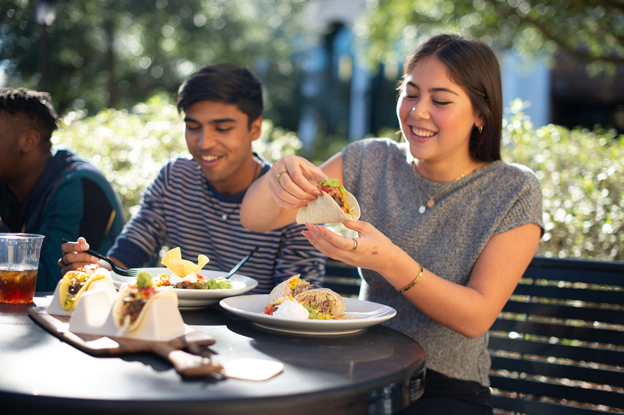 Rollins students enjoy fresh tacos outside the Cornell Cafe.