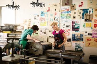 Studio art majors in a printmaking studio.